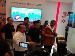 direktur-utama-telkomsel-ririek-adriansyah-tengah-bersama-presiden-ri-joko-widodo.jpg