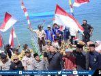 foto-pembentangan-bendera-di-permukaan-wisata-danau-ranau-senin-1282019.jpg
