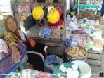 gimi-salah-seorang-pedagang-di-pasar-2-ulu-palembang-siap-diguyur-proyek-jembatan-musi-vi.jpg