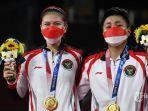 greysia-poliiapriyani-rahayu-berpose-dengan-medali-emas-olimpiade-tokyo.jpg