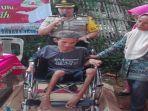 kapolres-oku-bantu-kursi-roda.jpg