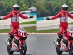 pembalap-ahrt-nomor-12-lucky-hendriansya-melakukan-selebrasi-berdiri-di-sepeda-motornya.jpg