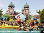 pengunjung-amanzi-waterpark-palembang-berpose-bersama-barongsai.jpg