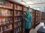 pengunjung-saat-membaca-buku-di-perpustakaan-daerah-prusda-lahat_20180916_135324.jpg