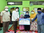 penyaluran-bantuan-untuk-1500-anak-yatim-dari-pt-pusri-palembang.jpg
