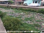 sampah-memenuhi-sungai-bendung-palembang-rabu-9102019.jpg
