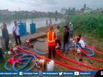 satgas-pengendali-banjir-bbwss-viii-saat-menyedot-banjir-di-palembang.jpg