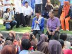 walikota-palembang-h-harnojoyo-kaos-biru-pakai-peci_20160917_140325.jpg