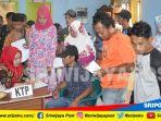 warga-antusias-ikut-rekam-ktp-di-kegiatan-bhakti-tmmd_20180713_105158.jpg