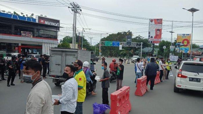 Diinisiasi Pengurus Non Muslim, FKUB Sulteng Bagikan 500 Makanan Buka Puasa di Palu