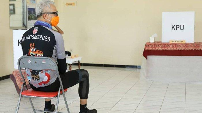 Potret Gubernur Jateng Pakai Jersey Sepeda saat Nyoblos, Ganjar Pranowo Gowes ke TPS: Gak Usah Takut