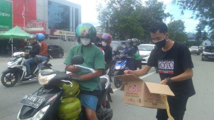 Jurnalis di Palu Bagikan 1.000 Masker dan Vitamin ke Masyarakat