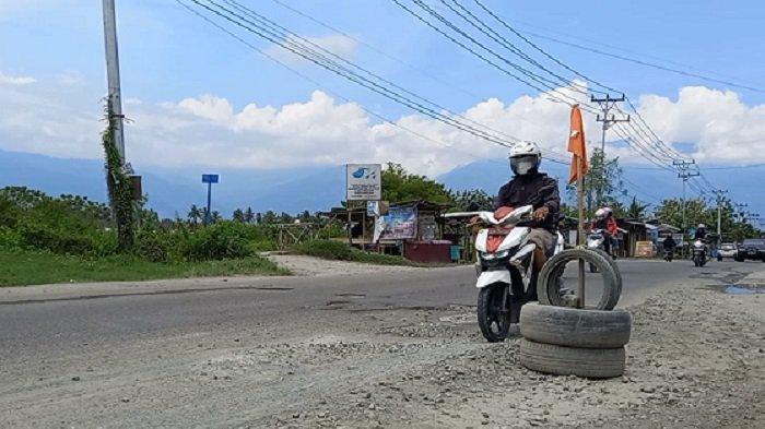 34 Lubang Ancam Keselamatan Pengguna Jalan Karanjalembah di Sigi