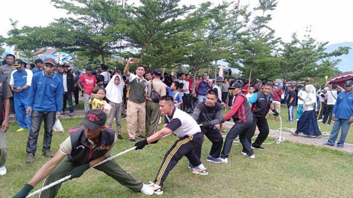 Polres Palu Meriahkan HUT Bhayangkara ke-73 dengan Aneka Lomba di Lapangan Vatulemo