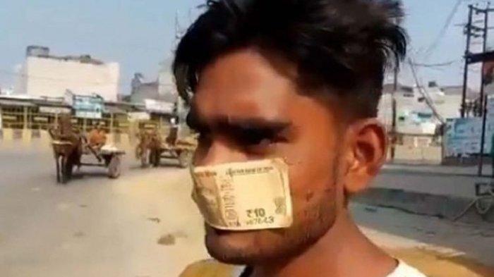 Ditegur karena Tak Pakai Masker, Pria di India Ini Gunakan Uang Rp 10 Rupee untuk Menutupi Mulutnya