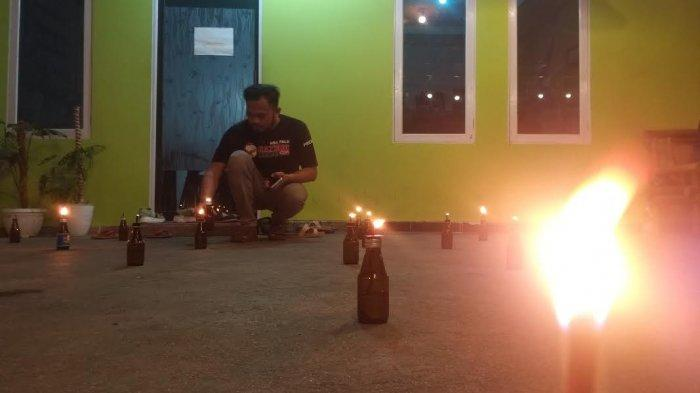 Rindu Kampung Halaman, Kekurukan Keluarga Gorontalo Gelar Tradisi Tumbilotohe di Palu