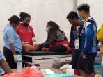 atlet-sulteng-cabor-paralayang-saat-ditangani-tim-medis-ketika-cedera.jpg