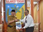 gubernur-provinsi-sulteng-menerima-laporan-pengawasan-dari-kantor-perwakilan-bpkp.jpg
