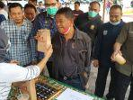 gubernur-sulawesi-tengah-rusdi-mastura-dipameran-kopi-dan-cokelat-olahan-umkm-di-kota-palu.jpg
