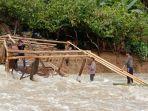hujan-deras-mengakibatkan-sungai-di-kecamatan-dondo-toli-toli-meluap-melimpas-permukiman-warga.jpg