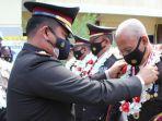 kepolisian-resor-polres-palu-melaksanakan-upacara-wisuda-purnabakti.jpg