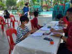 pelaksanaan-vaksinasi-di-milenium-waterpark-jl-emmy-saelan-no17-kelurahan-lolu-selat.jpg