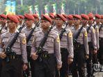 petugas-kepolisian-melakukan-aksi-gladi-kotor-upacara-hut-bhayangkara.jpg