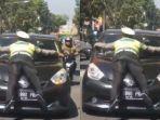 viral-polisi-hentikan-mobil-dengan-nempel-di-jendela.jpg