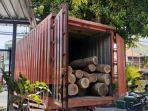 truk-bertuliskan-pos-indonesia-kayu-ilegal.jpg