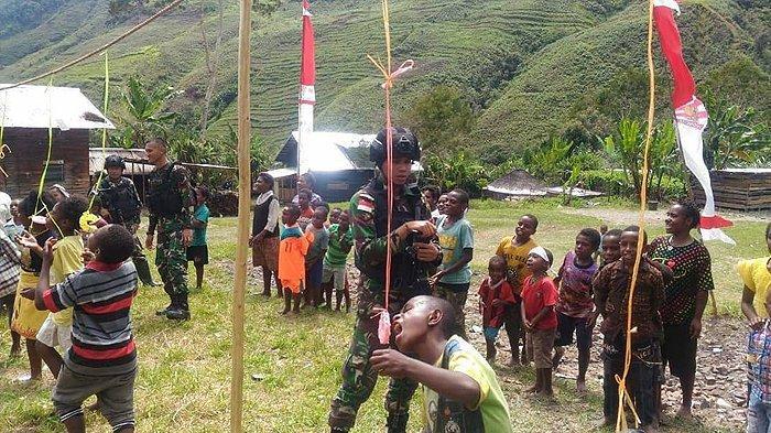Kemeriahan Suasana Perlombaan Anak-Anak di Puncak Jaya Papua dalam Rangka  Sambut HUT Kemerdekaan RI
