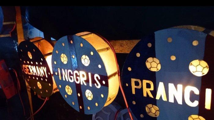 LAMPU HIAS - Inilah hasil karya Stenly Kawatu pengrajin lampu hias daur ulang turun menyemarakkan Piala Eropa 2020.