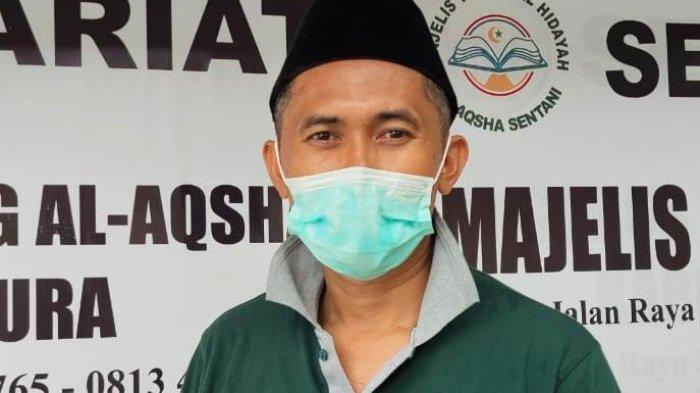 Kisah Taufiq Muhammad, 20 Tahun Dipercaya Jadi Penyembelih Hewan Kurban di Sentani