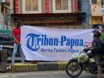 18062021-spanduk-tribun-papua-1.jpg