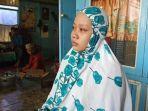 fitri-anak-ketiga-korban-suyono-56-saat-menceritakan-kejadian-yang-menimpa-ayahnya.jpg