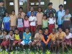 kekurangan-guru-sd-di-kabupaten-keerom-papua-mendapat-bantuan-tenaga-pengajar-dari-prajurit-tni.jpg