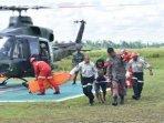 kondisi-evakuasi-jenazah-di-bandara-timika.jpg