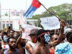 mahasiswa-papua-unjuk-rasa-di-depan-istana.jpg