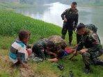 prajurit-satgas-yonif-mr-411pdw-kostrad-selamatkan-anak-tenggelam-di-sungai.jpg