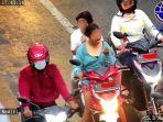 video-viral-wanita-makan-saat-naik-motor-diingatkan-petugas.jpg