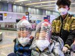 warga-china-pakai-botol-plastik-untuk-melindungi-bagian-kepala-mereka-dari-virus-corona.jpg