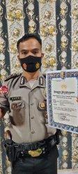 Sukses Bina Warga Siak Hulu Kampar, Brigadir David Terima Piagam dan Pin Perak dari Kapolri