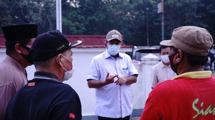 Bupati Siak Datangi Warga di Tualang Memberikan Pemahaman Pentingnya Memakai Masker