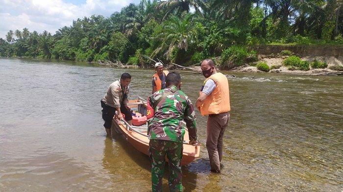 Tim gabungan tengah melakukan pencarian dan penyisiran di sekitar lokasi tenggelam di Sungai Batang Lubuh, Minggu (14/3/2021).