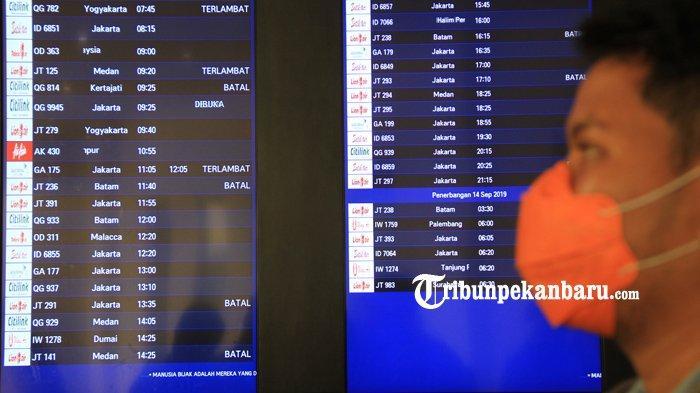 FOTO: Akibat Kabut Penerbangan di SSK II Pekanbaru Sempat Terganggu - foto_akibat_kabut_penerbangan_di_ssk_ii_pekanbaru_sempat_terganggu_1.jpg