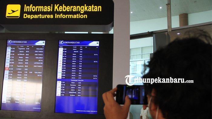 FOTO: Akibat Kabut Penerbangan di SSK II Pekanbaru Sempat Terganggu - foto_akibat_kabut_penerbangan_di_ssk_ii_pekanbaru_sempat_terganggu_2.jpg