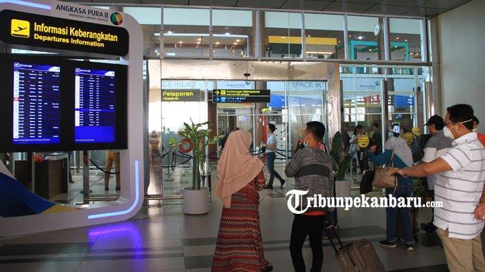 FOTO: Akibat Kabut Penerbangan di SSK II Pekanbaru Sempat Terganggu - foto_akibat_kabut_penerbangan_di_ssk_ii_pekanbaru_sempat_terganggu_3.jpg