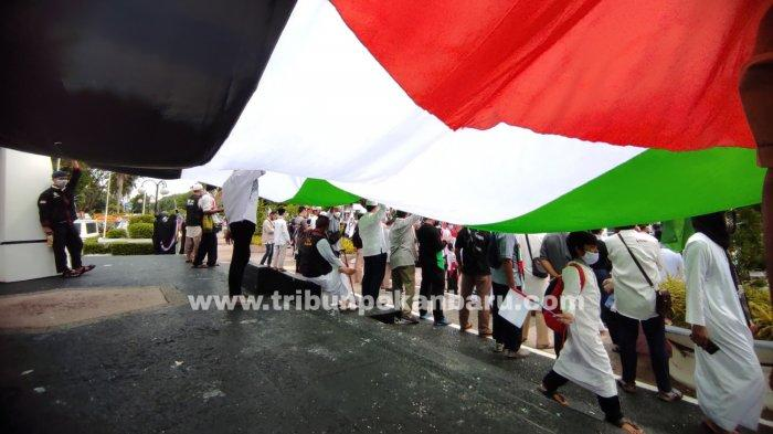 FOTO: Aksi Solidaritas Bela Palestina di Pekanbaru - foto_aksi_solidaritas_bela_palestina_di_pekanbaru-2.jpg