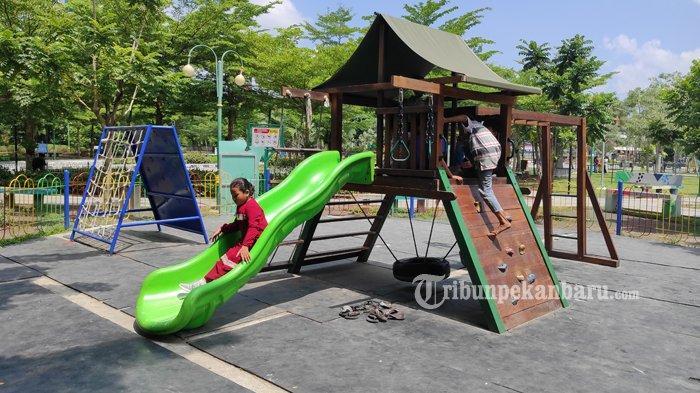 FOTO: Bermain di Ruang Terbuka Hijau di Pekanbaru - foto_bermain_di_ruang_terbuka_hijau_kaca_mayang_pekanbaru_3jpg.jpg