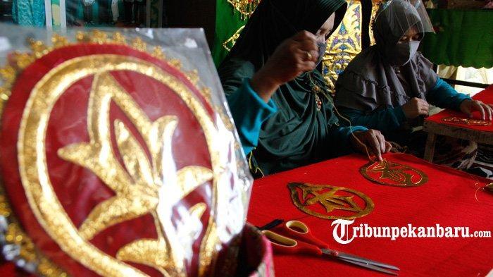 FOTO: Mengenal Tekat, Sulaman Khas Melayu Riau - foto_mengenal_tekat_sulaman_khas_melayu_riau_2.jpg
