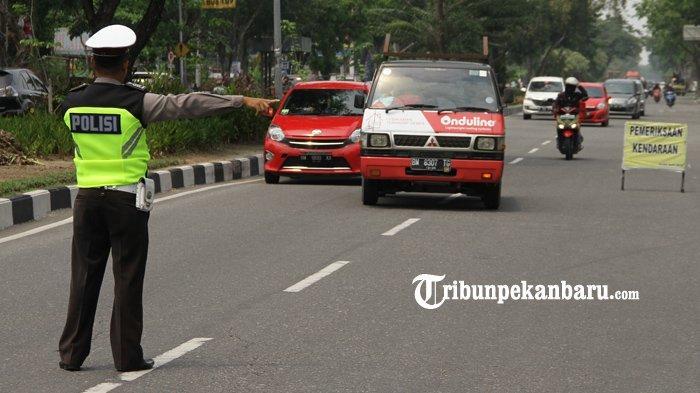 FOTO: Operasi Zebra Muara Takus 2019 di Jalan Arifin Ahmad di Pekanbaru - foto_operasi_zebra_muara_takus_2019_di_jalan_arifin_ahmad_di_pekanbaru_1.jpg